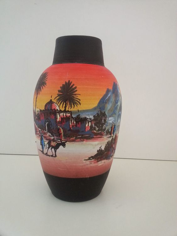 Moroccan Hand-Painted Vase, Agadir in aaALLHouseSale_worldwideitems' Garage Sale in Kenosha , WI for $35. Moroccan pottery with a beautiful painted picture of a typical Moroccan landscape. It was brought here personally from Agadir, Morocco.