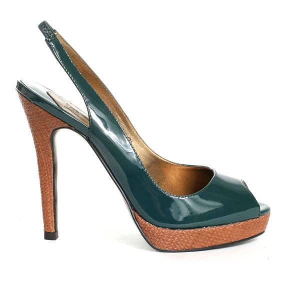 Check out this sexy new platform sling back from oh...DEER! A glossy green patent upper is paired with a basket weave pattern on the 1/2 inch platform and tall 4 1/2 inch heel. The sling back is elasticized for added comfort and a better fit.