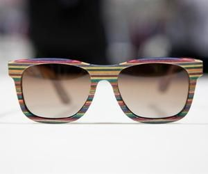 The retro inspired frames are constructed from recycled, multicolored layered wood complete with the brand's engraving found on each of the temple stems