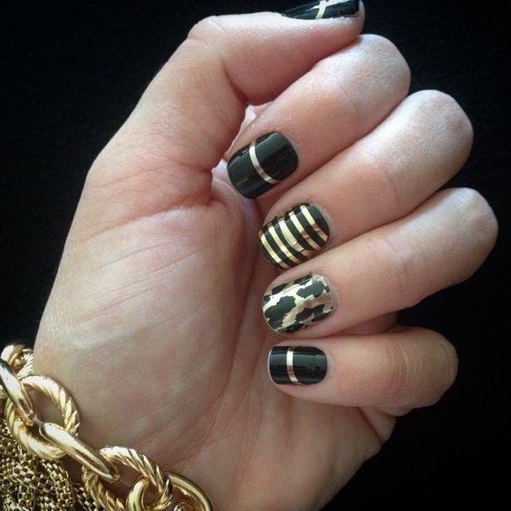 """My new manicure! Love my @jamberrynails! #goldstreakjn #goldleopardjn #metallicgoldpinstripejn #jamberrynails #newhashtagsmatt!"""