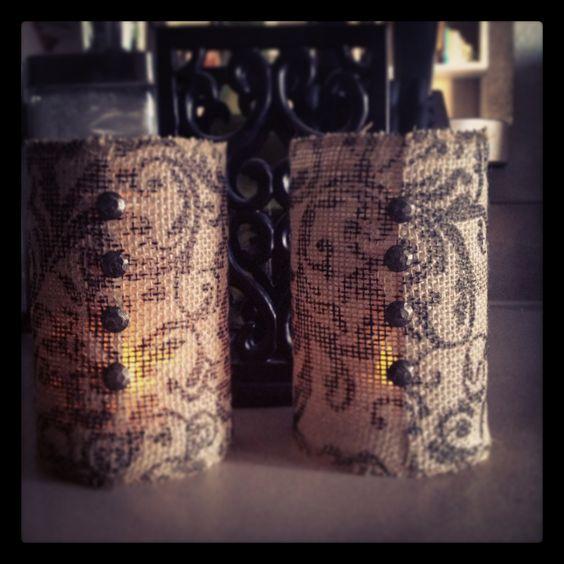 Burlap covered jars.