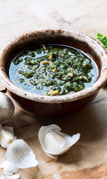 Heavily seasoned with chives, parsley, shallots and capers, this versatile French sauce can be prepared hot or cold. Its light flavor is best balanced out with proteins like fish, grilled meat, or if you're feeling gutsy, this boiled cow's head.  #saveurlovesfrance