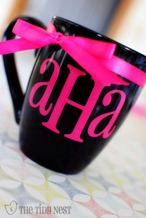 plain black coffee mug from the dollar store apply permanent vinyl and add a ribbon.