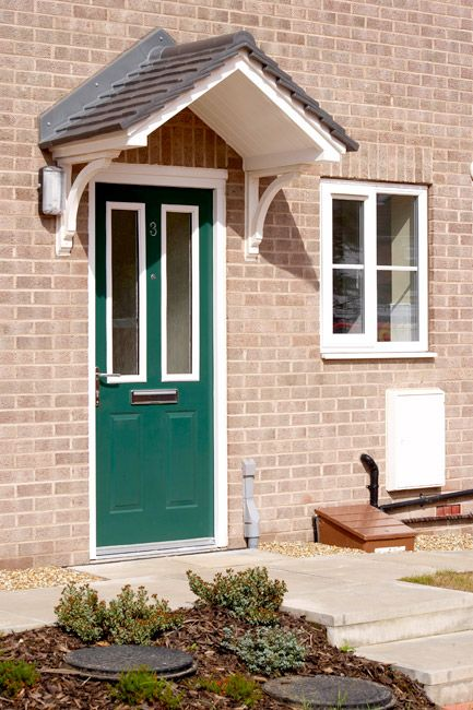 Green and white composite door with 2 panel glass
