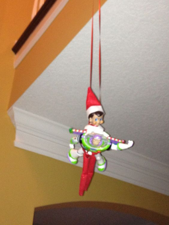 Buzz giving Buddy The Elf on the shelf a ride