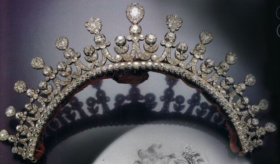 """""""Kleines Diadem"""" a diamond tiara of the Thurn & Taxis family, early 1800s. Designed as a crescent of paired volutes and foliage, capped with detachable pear-shaped cluster drops, set throughout with cushion-shaped diamonds. Provenance: Therese, Duchess of Mecklenburg-Strelitz. She married Erbprinz Carl Alexander von Thurn und Taxis, who succeeded his father as Fürst in 1805."""