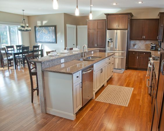 Open concept kitchen with hickory stained perimeter cabinetry linen white painted island - Open concept kitchen design ...
