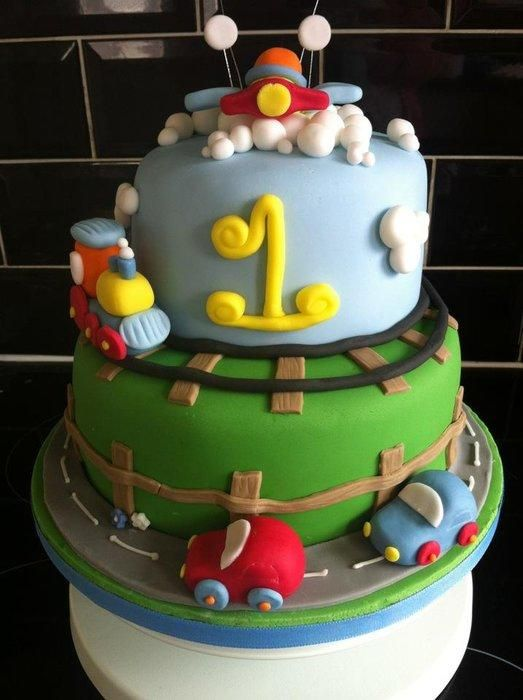 A two tier cake designed for a little boy celebrating his first brithday. Rafe loved his cars, trains and aeroplanes!