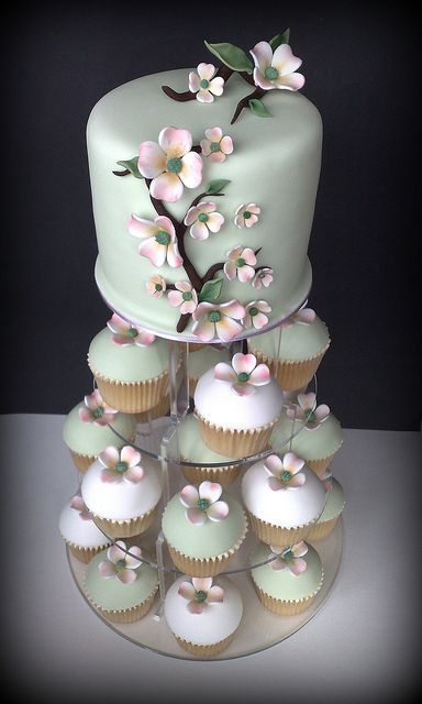 DOGWOOD WEDDING TOWER Dogwood Cutting Cake With Co Ordinating Cupcakes In White Hint Of Apple Green Colours Topped A Single Bloom