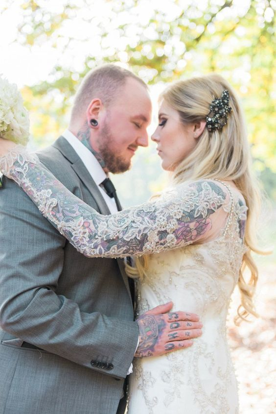 bride with tattoo covered in lace