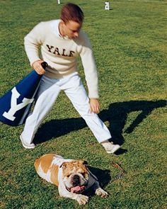 Yale Cheerleader with Handsome Dan. Cheerleader is wearing the traditional Yale Boat neck letter sweater.