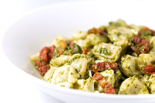 FANTASTIC! Cheese Tortellini with Pesto and Sun Dried Tomatoes. I used frozen tortellini and added artichokes, pepperoni that I had and ricotta cheese. YUM YUM YUM!