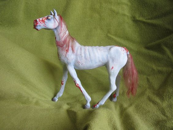 a ooak zombie horse sculpture made of polymer clay