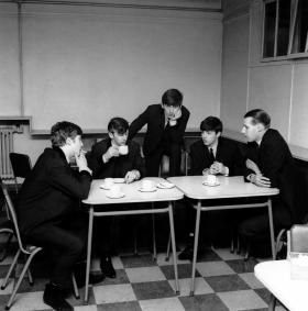 The Beatles with George Martin on a tea break in the EMI canteen, London England. March 5, 1963