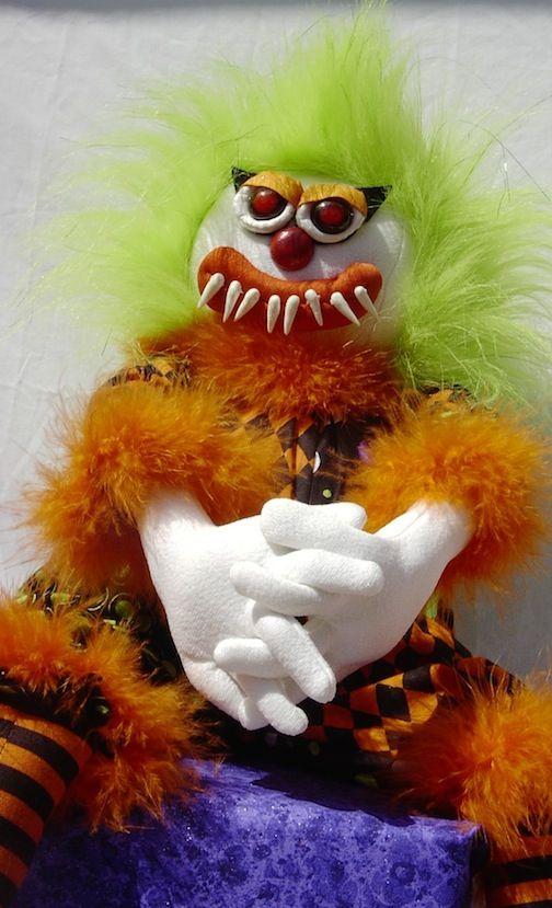 Evil KimB Klown with folded hands again