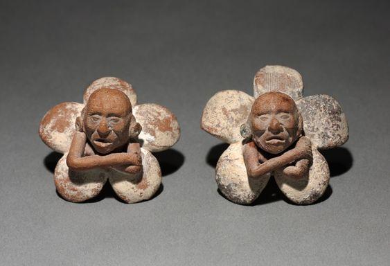 Pair of figure in flower ornaments. Mexico, Yucatán, Jaina Island region, Campeche, Maya style (250-900).:
