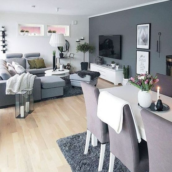 A Graphite Grey Statement Wall With Artworks And A Tv Takes Over The Wh Apartment Living Room Design Contemporary Living Room Design Formal Living Room Designs #statement #wall #living #room