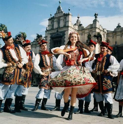 Poles in traditional dress dance in Market Square, Kraków. Poland