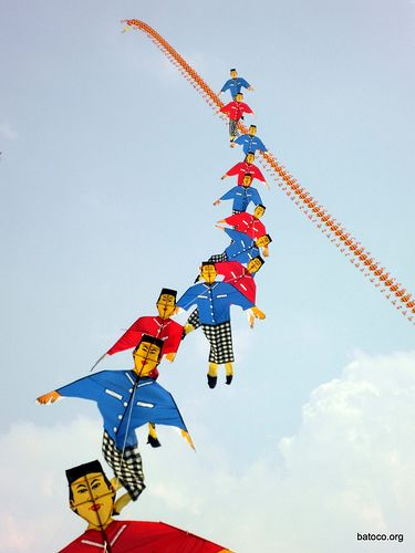 Kite trains in Indonesia - note the national dress of the figures. T.P. (my-best-kite.com)