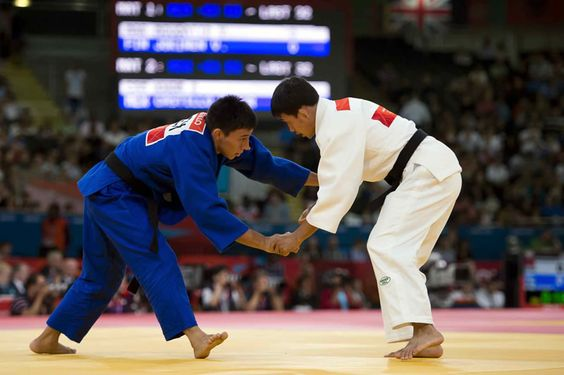 Nabor Castillo of Mexico (blue) vs Cameroon RatanaKmony Khom, during the London 2012 Olympic Games.