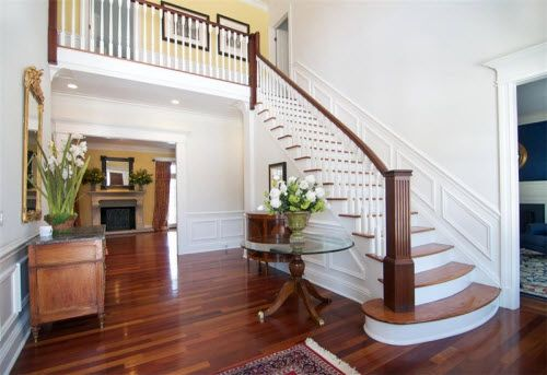 Staircase And Cherry Hardwood Floors Inside A Beautiful