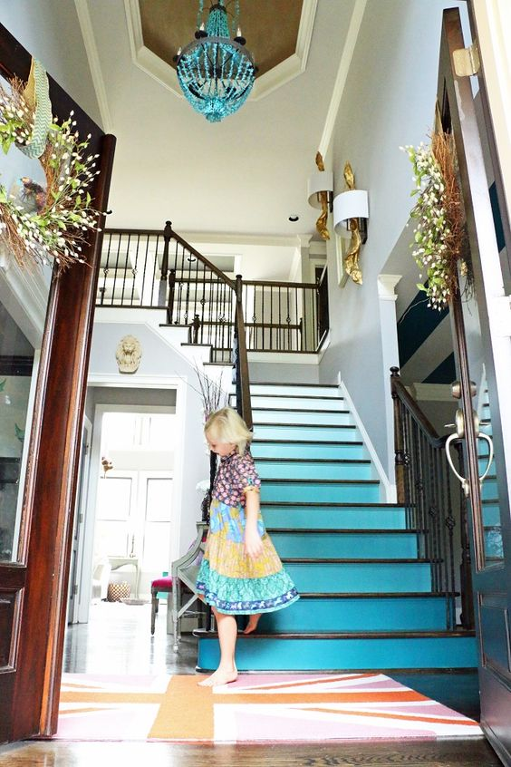 Addison's Wonderland Stairway to Ombre Heaven Tutorial... Grey Walls, Foyer, Turquoise Teal Beaded Chandelier, Gold Driftwood Sconces, British Flag Rug, Ghost Chair, Dark Wood Floors, Ombre Stairs, Sherwin Williams Really Teal, Matilda Jane