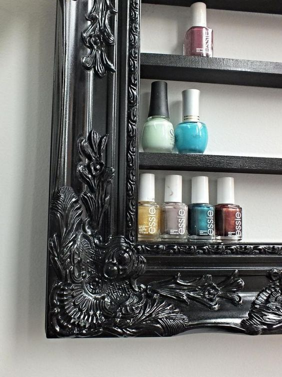 This would be soo easy to make. Picture frame with wood slats. Nail polish holder.: