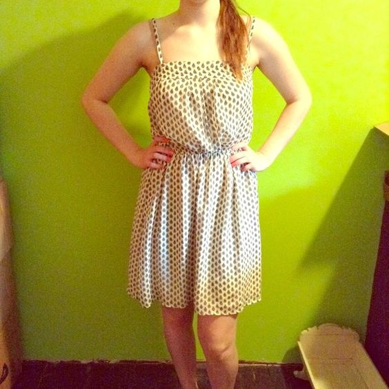 Short sundress Flowy, creamy colored with small feathered pattern Dresses