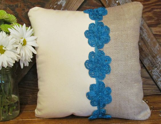 Rustic Chic pillow but with orange, rust, or brown flowers instead of blue.