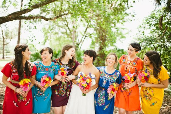 Bridesmaids in Mexican dresses. So freakin awesome.