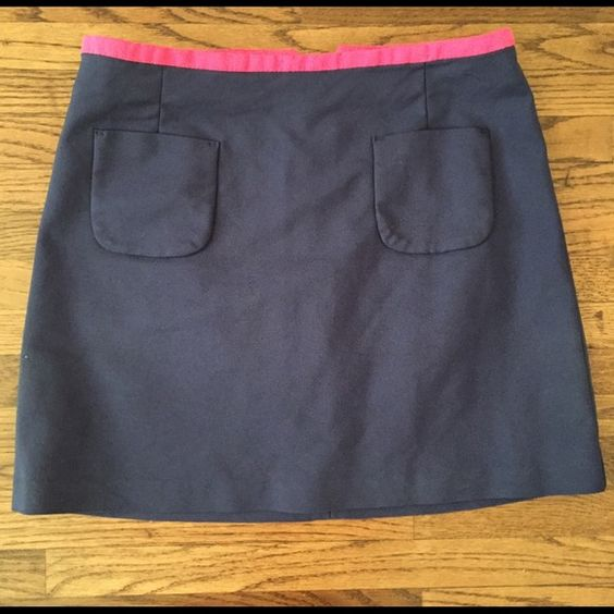 Navy skirt Navy blue mini skirt from H&M. Hot pink trim at the top and two pockets on the front. Size is US 4 / Euro 34. No trades H&M Skirts