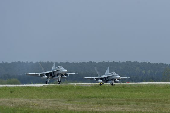 Royal Canadian Air Force CF-18 pilots land fighter aircraft on flightline May 1, 2014, Spangdahlem Air Base, Germany. Fighter aircraft, along with support personnel, travelling to Romania in order to conduct training activities as part of NATO reassurance measures to Central & Eastern Europe. 52nd Fighter Wing and 726th Air Mobility Squadron at Spangdahlem are forward-based, with ready forces equipped to further enable NATO operations & enhance partner readiness.(USAF Senior Airman Rusty…