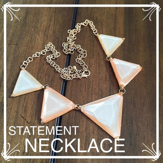 Peach Triangle Statement Necklace This adorable necklace has a light gold chain with 5 shimmery peach colored triangles ranging in sizes. Has a lobster claw closure and is in great condition. Never worn. Great statement piece! Deb Jewelry Necklaces