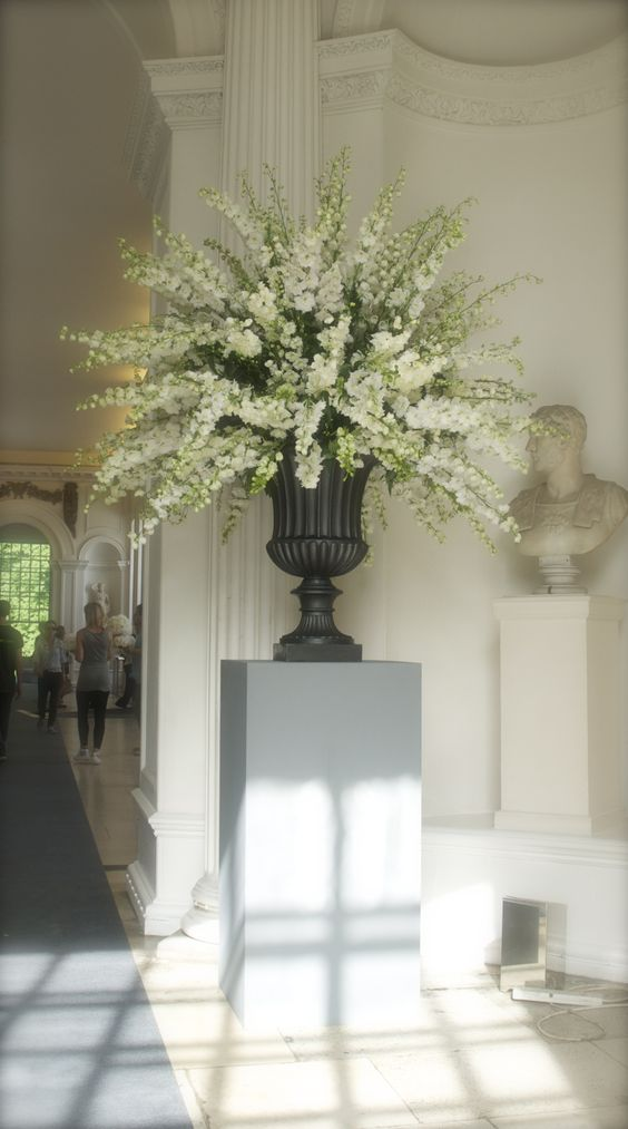 New centerpiece idea, not sure if delphinium, but like the large look (of course would not be in an urn)