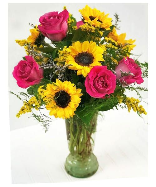 Bright Sunflowers Arranged With Hot Pink Roses Are The Perfect Combination For Any Occasion Blossomflowers Savethebees Sun Rose Flower Arrangements Pink Rose Flower Hot Pink Roses