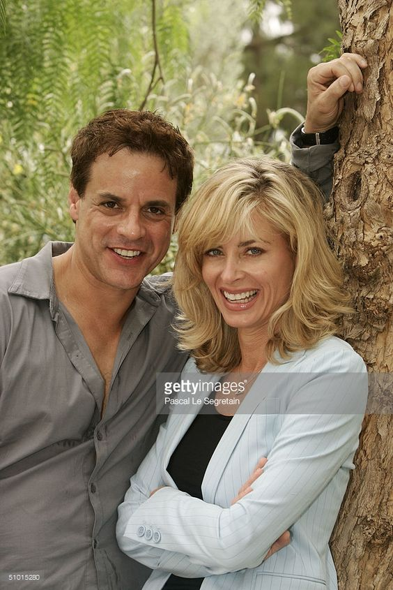 U.S actress Eileen Davidson (right) poses with U.S actor Christian Jules Leblanc (left) during a photocall at the 44th Monte-Carlo Television Festival on July 1, 2004 held in Monte Carlo, Monaco. Davidson and Leblanc are in Monaco to present 'The Young and the Restless'. The Celebration of Global Television runs from June 28 - July 3 and will feature television stars from around the world.