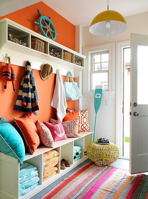 A tangerine accent wall punches up any entryway to welcome guests in cheerful style!