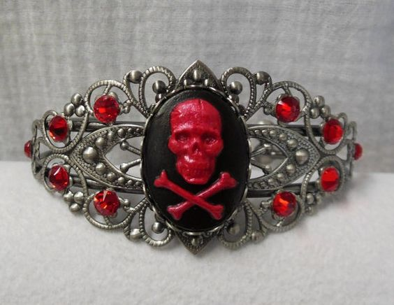 I found 'Anitque Silver Filigree Bracelet. Hand Painted Red Pearl Shimmer Skull & Crossbones Cameo. Red Siam Swarovski Crystal Accents' on Wish, check it out!