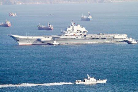 The Chinese PLAN aircraft carrier Liaoning departs on its first mission after entering service in 2012. (Photo/CNS).