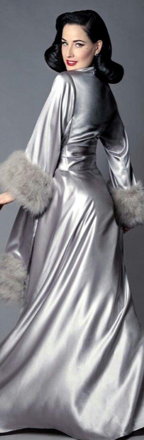 Dita Von Teese in silver gray satin robe w/fur sleeves.