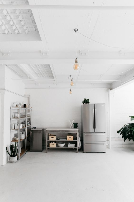 Half of the Rye kitchen in London is comprised of stainless steel workbenches and appliances. For more see Kitchen of the Week: An Artful Ikea Hack Kitchen by Two London Foodies.