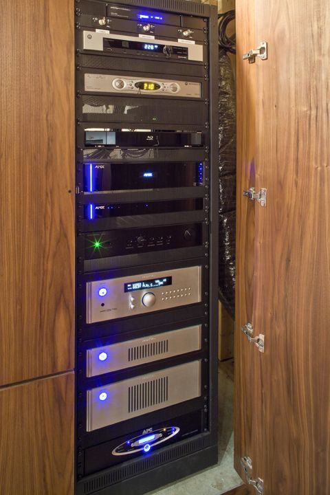 Cabinet neatly conceals media room/home theater equipment rack | Basement Transformation | CEDIA Media Room Design Ideas