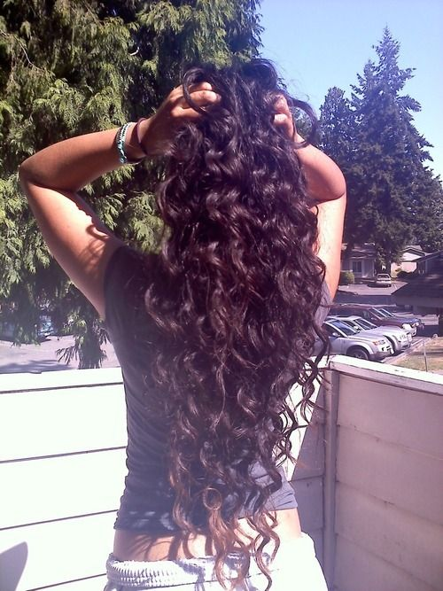 This is exactly what I have been trying to achieve with my hair...length=check, curl?  Not so check.  = (