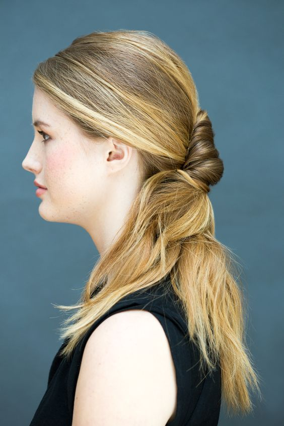 A hybrid of a low pony and modern chignon will instantly make you look polished.   - Cosmopolitan.com
