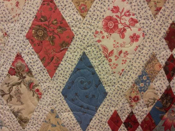 Longarm Chris:  French General Fabric, quilted with Fleur de lis