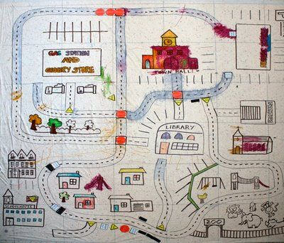 Dollar store shower curtain play village (draw with permanent marker then let the kiddos color it in and drive their cars around on it).: