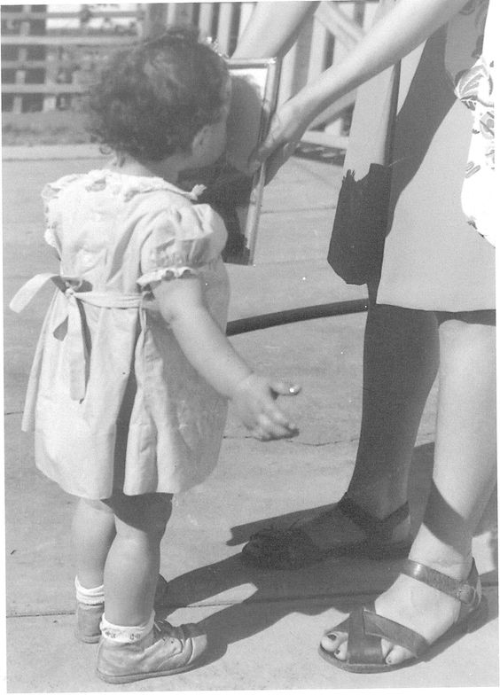 """Shared by Jo Saunders in our Father's Day Contest: """"Kissing my daddy's photo when he was away during WW2"""" #vintagephotos #fathersday #WWII"""