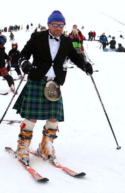 """6 March 2010: 235 kilted skiers and snowboarders took part in a record-setting attempt on Cairngorm Mountain near Aviemore, skiing in a single consecutive line from the Ptarmigan Top Station all the way down to the car park. The procession was lead across the finish line by two pipers and a drummer. Snow conditions for the record attempt were described as """"phenomenal"""" by officials at the mountain. Money raised from entry fees will"""