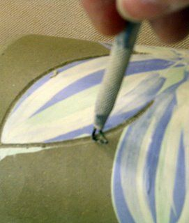 Emily Murphy Wax resist and underglaze/ slip inlay A great way to make a clean line without too much mess, step by step.