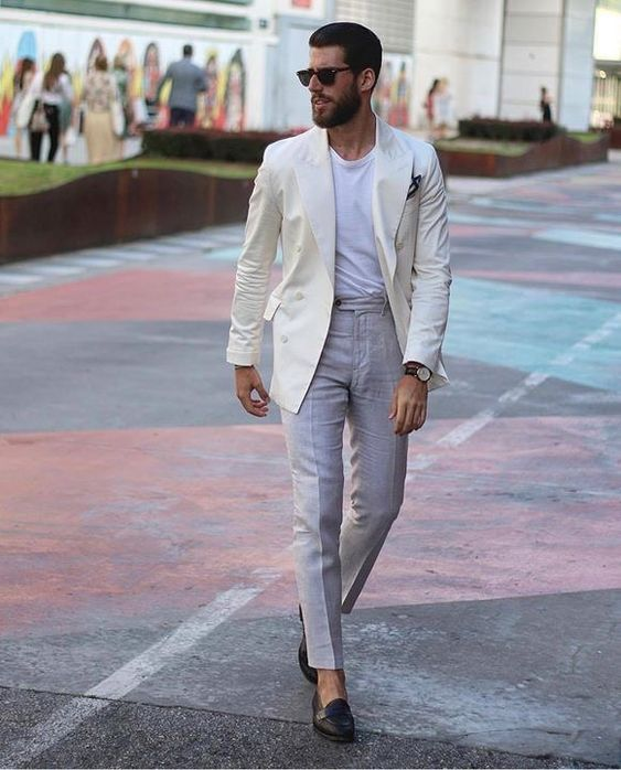 Dapper summer combo inspiration with a while linen double breasted blazer gray trousers white t shirt no show socks dark brown penny loafers #businesscasual #linen #summeroutfits #menswear #mensfashion #menstyle #loafers #mensapparel